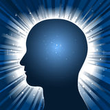 Head silhouette with star burst background Stock Images