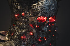 Head, silver armor skull with red eyes and led lights, helmet me Royalty Free Stock Image