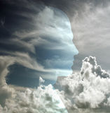 Head in sky. Head revealed in cloudy sky Royalty Free Stock Photo