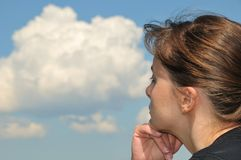 Head in sky - dreaming young woman Royalty Free Stock Photos