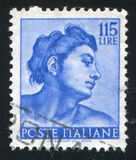 Head of the slave. ITALY - CIRCA 1961: stamp printed by Italy, shows Designs from Sistine Chapel by Michelangelo, Head of the slave, circa 1961 Royalty Free Stock Photos