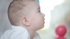 Head of a small baby side view. Video full hd stock footage