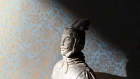 Head of small terracotta warrior with brocade background Royalty Free Stock Photos