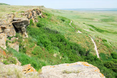 Head-smashed-in buffalo jump. The sandstone cliffs and trail in the head-smashed-in buffalo jump historic site, alberta, canada. This site had been used by Stock Photography