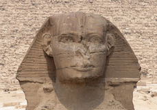 Head of the Sphinx with the  Pyramid of Khafre. Head of the Sphinx with the limestone blocks of the Pyramid of Khafre in the background Royalty Free Stock Image