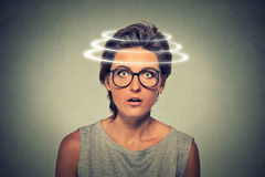 Head is spinning. Surprise astonished woman Stock Images