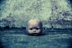 Head of spooky doll in haunted house. Spooky doll in haunted house,Scary background for book cover Stock Images