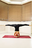 Head stand legs stretched Royalty Free Stock Photos