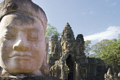Head of statue at gate to Angkor Thom Royalty Free Stock Photos