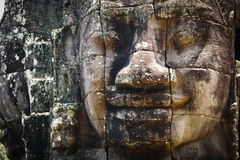 Head Staute of Bayon Temple in Angkor Thom Stock Photo