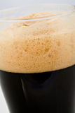 Head on stout. The foam head on stout beer Stock Photography