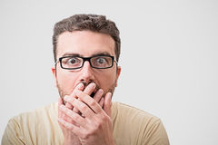 Head of surprised man portrait on  background. Head of surprised geek man portrait   on gray background Stock Images