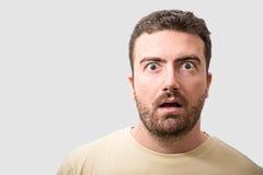 Head of surprised man portrait on gray background. Head of surprised man portrait   on gray background Stock Photos