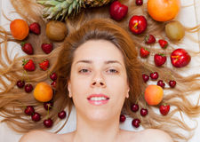 Head surrounded with fruit Royalty Free Stock Photo