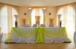 Head table for the newlyweds. Head table for the newlyweds at the wedding hall Stock Image