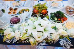 Head table for newlyweds at the wedding hall. Head table for the newlyweds at the wedding hall Stock Photos