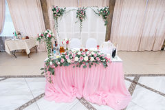 Head table for the newlyweds at the wedding hall. Head table for the newlyweds at the wedding hall Royalty Free Stock Photo