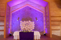 Head table for the newlyweds at the wedding hall. Main table of the bride and groom in a wedding hall Stock Image