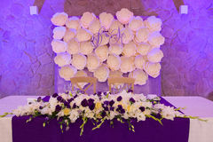Head table for the newlyweds at the wedding hall. Stock Photo