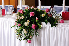 Head table at wedding reception decorated. With flowers Royalty Free Stock Photos