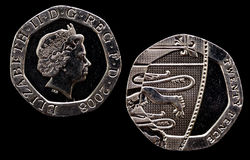 Head and Tail of Twenty pence piece. Close-up of the head and tail of a British twenty pence coin against a black background Royalty Free Stock Image