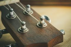 Head of ukulele and knob with morning light. Suitable for background music articles Royalty Free Stock Photography