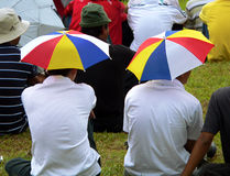 Head Umbrellas. On Spectators SE Asia royalty free stock images