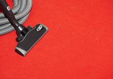 Head of a vacuum cleaner on a red carpet Stock Image