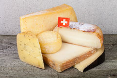 Head and various pieces of cheese on a wooden table Royalty Free Stock Image
