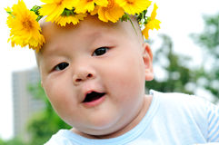 Head wearing a wreath of lovely babies Royalty Free Stock Photo