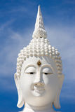 Head of white buddha against blue sky. Royalty Free Stock Photos