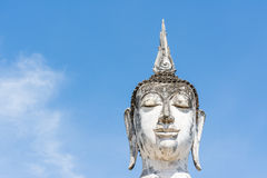 Head of white Buddha image and blue sky Stock Image