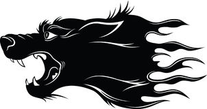 Head  of wolf. Black silhouette of a head of a wolf with a flame Stock Photos