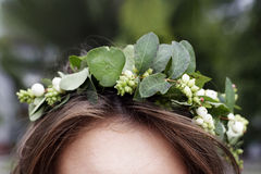 Head of a woman with circlet of flowers Stock Image
