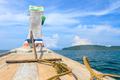 Head of wooden boat toward the tropical sea in sunny day Stock Photos