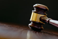 Head of a wooden brass bound gavel Stock Image