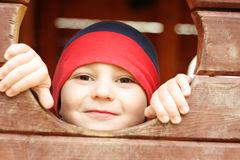 Head in wooden hole Royalty Free Stock Image