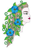 Head young beautiful girl with blue  flower in the long hair Stock Images