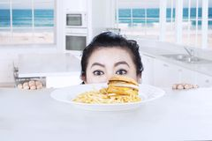Head of woman with cheeseburger at home Royalty Free Stock Image