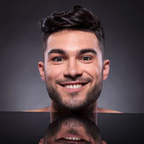 Head of young man with smug expression Stock Photography