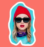 Head of a young style girl in cap and sunglasses on blue and living coral color background. Trend pantone of 2019 stock images