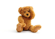 Headache. Poor little bear with a headache on white royalty free stock image
