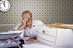 Headache. Overworked businessmen scratching his head because of a huge headache Stock Photography