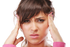 Headache. Young brunette woman suffers from headache pressing temples with hands Royalty Free Stock Photography