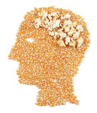 Headache. Popcorn in the head of a human has symbolically burst in pain Stock Image