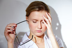 Headache. Portrait of young businesswoman having headache pains Royalty Free Stock Image