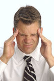 Headache. Business man with terrible headache isolated on white background Royalty Free Stock Photos