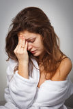 Headache. Young woman suffering from headache Royalty Free Stock Photo