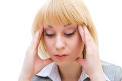 Headache. A young blonde woman suffers from headache Stock Image