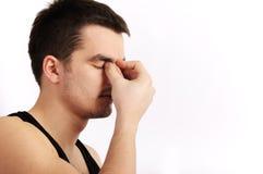 Headache. Young man having a headache Stock Images